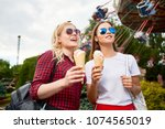 two happy girls with icecreams... | Shutterstock . vector #1074565019
