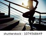 sporty fitness female runner... | Shutterstock . vector #1074568649