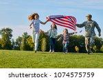 shot of patriotic family... | Shutterstock . vector #1074575759