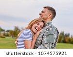 Married Soldier Hugging Wife...