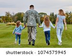 back view soldier's family...   Shutterstock . vector #1074575945