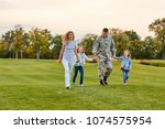 happy family walking on the... | Shutterstock . vector #1074575954