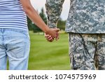 hands holding  back view.... | Shutterstock . vector #1074575969
