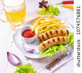grilled bratwurst with chips... | Shutterstock . vector #1074576881
