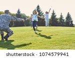 daughters are running to their... | Shutterstock . vector #1074579941