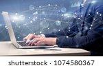 businessman typing on laptop... | Shutterstock . vector #1074580367