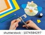 child makes bird from cd.... | Shutterstock . vector #1074584297
