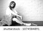 beautiful girl artist at work...   Shutterstock . vector #1074584891