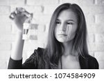beautiful girl with tears in...   Shutterstock . vector #1074584909