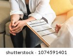 doctor or psychiatrist... | Shutterstock . vector #1074591401