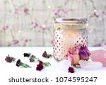 pink tones candle with dried... | Shutterstock . vector #1074595247