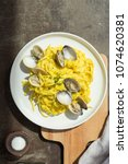 Small photo of Linguine alfredo with saffron clams plating food styling
