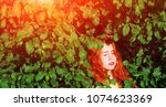 beautiful red haired girl among ...   Shutterstock . vector #1074623369