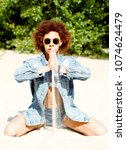 beautiful young african...   Shutterstock . vector #1074624479