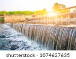 a dike or drainage dam with...   Shutterstock . vector #1074627635