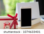 desk work at home phone with... | Shutterstock . vector #1074633401
