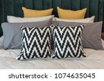 set of pillows on bed in... | Shutterstock . vector #1074635045