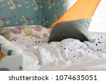 kid's bedroom with cozy bed and ... | Shutterstock . vector #1074635051