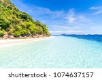 tropical white sand beach at... | Shutterstock . vector #1074637157