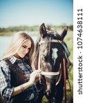 girl cowboy hugging gently horse   Shutterstock . vector #1074638111