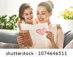 happy women's day  child... | Shutterstock . vector #1074646511