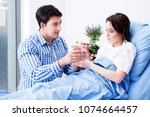 caring loving husband visiting... | Shutterstock . vector #1074664457
