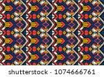 ikat geometric folklore... | Shutterstock .eps vector #1074666761