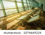 soft comfortable sunbeds in the ... | Shutterstock . vector #1074669224