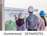 group of engineer checking the... | Shutterstock . vector #1074690701