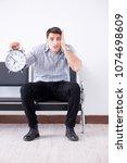man nervously impatiently... | Shutterstock . vector #1074698609
