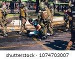 santiago  chile   april 19 ... | Shutterstock . vector #1074703007
