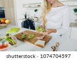 mother preparing school lunch... | Shutterstock . vector #1074704597