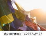Colorful flags with vivid color use as tailsman for safety travel in tibetan with sunset background