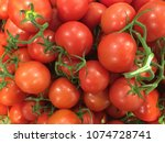 red tomatoes in a supermarket... | Shutterstock . vector #1074728741