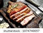 grilled beef steak on a... | Shutterstock . vector #1074740057