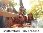 happy friends grilling meat and ... | Shutterstock . vector #1074765815