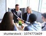 business people shaking hands ... | Shutterstock . vector #1074773609