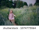 Cute Toddler Girl In A Purple...
