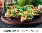 bruschetta with fresh pesto ... | Shutterstock . vector #1074778019