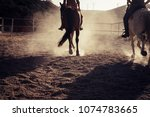 two horses run and ride in the... | Shutterstock . vector #1074783665