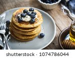 banana oat pancakes with... | Shutterstock . vector #1074786044