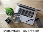 top view.laptop  calculator and ... | Shutterstock . vector #1074796205