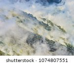 sulphur gas coming out of the... | Shutterstock . vector #1074807551