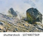 sulphur gas coming out of the... | Shutterstock . vector #1074807569