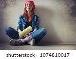 the girl is doing repairs in... | Shutterstock . vector #1074810017