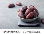 fresh medjool dates in bowl.... | Shutterstock . vector #1074833681