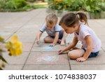 siblings playing in backyard  ...   Shutterstock . vector #1074838037