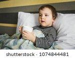 sick cute curing boy lying on... | Shutterstock . vector #1074844481