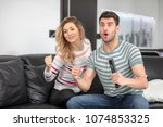 cute couple looking excited and ... | Shutterstock . vector #1074853325