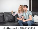 cute couple looking excited and ... | Shutterstock . vector #1074853334